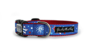 The Fireworks Dog Collar with red webbing and royal blue trim with red, white and blue fireworks and stars.