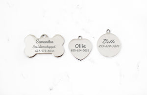 Engraved Silver Dog ID Tag with mirror finish in bone, heart and round shapes on a white marble background