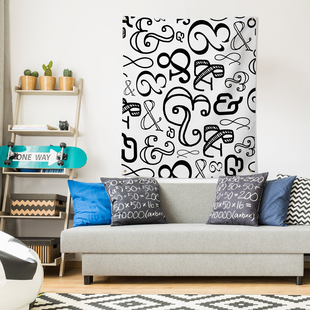ampersand wall tapestry hung over couch