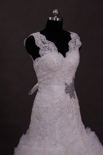 Mermaid beaded lace wedding dress with ruffled skirt
