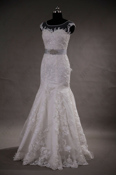 Mermaid lace wedding dress with beaded silver sash