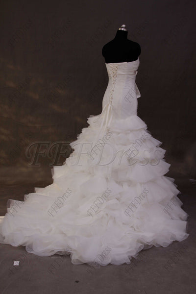 Mermaid wedding dress with tiered skirt