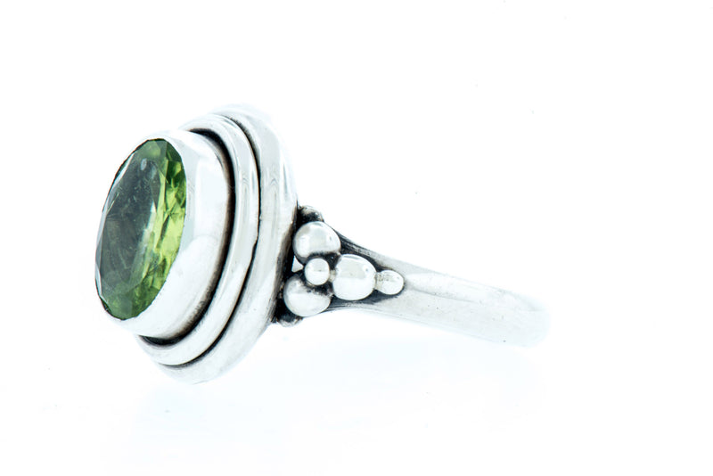 Handcrafted Sterling Silver Ring with Faceted Green Peridot