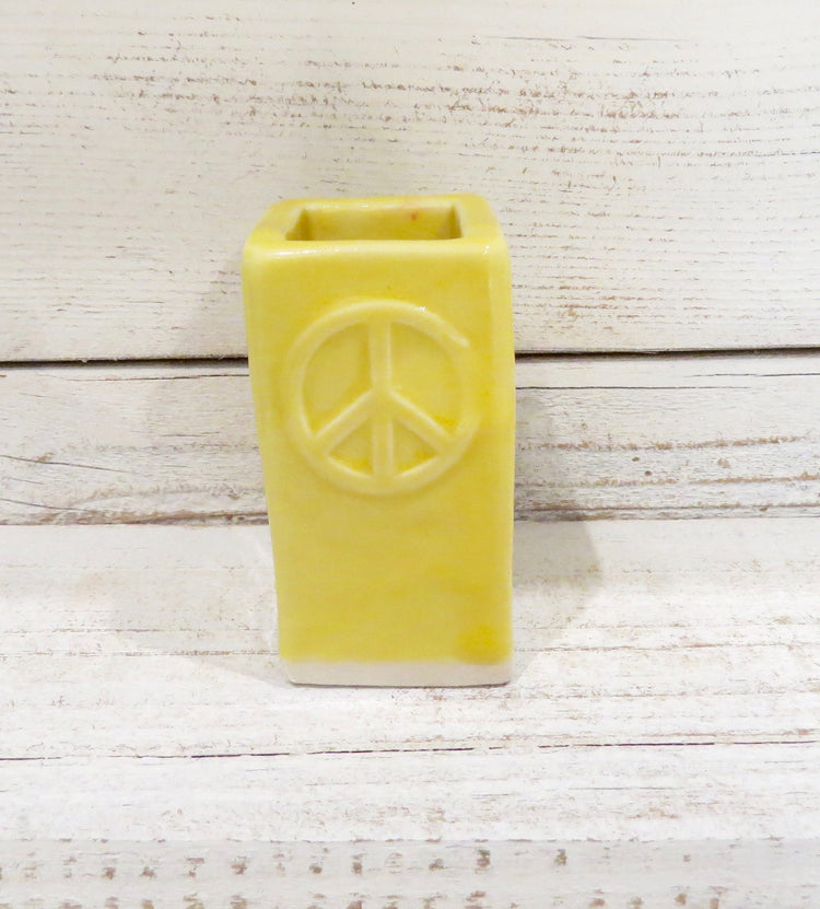yellow peace bud vase