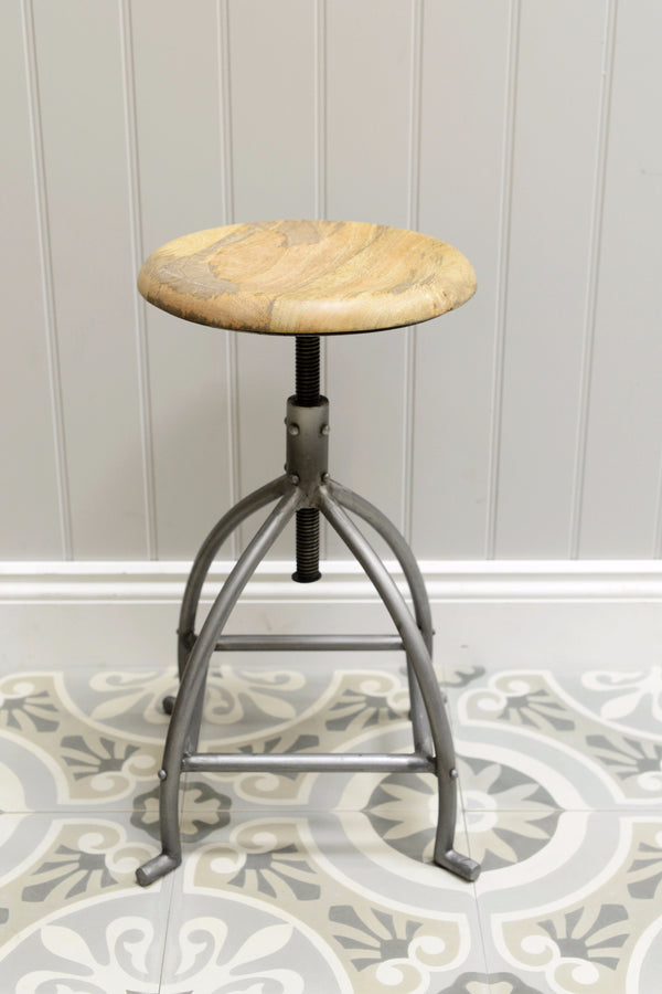 Natural Iron Malmo stool shot against grey background