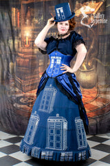 red headed model wearing a hand made victorian fantasy Dr Who Tardis themed cos play corset gown with top hat