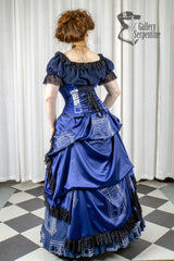 side back view showing hoop and over skirt worn by pre raphaelite model in this blue victorian cosplay costume for Dr Who Tardis fans made in Australia