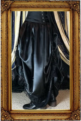 on model showing the Seraphina Ravenclaw skirt side on worn without a hoop skirt underneath in black satin