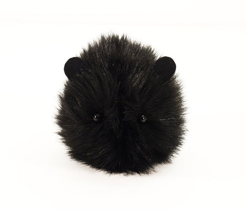 Coal the black guinea pig stuffed animal plush toy front view.