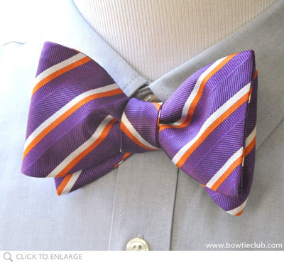 purple bow tie on shirt