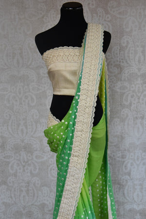 90B421 Green chiffon saree with a pop of blue and embroidered polka dots. This saree makes for the perfect Indian outfit for weddings and pujas. Buy this vibrant saree online in USA at Pure Elegance.