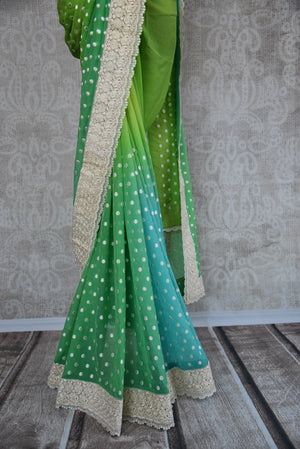 90B421 This green chiffon saree with a pop of blue and embroidered polka dots makes for a lovely Indian outfit for weddings and pujas. Buy this alluring saree online in USA at our ethnic wear store Pure Elegance.
