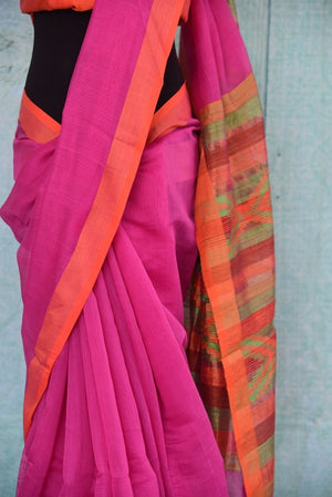 90B690 Half matka silk & half cotton saree in a vibrant shade of pink with an orange border and a multicolored pallu. The plain saree is a great ethnic outfit for Indian wedding functions & ethnic occasions. But this plain sari online at Pure Elegance.