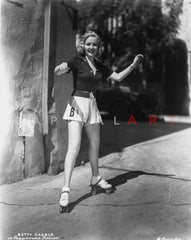 Betty Grable Portrait Hand on the near the Right Cheek in Strap Dress with Fur Boa on the Shoulders Premium Art Print