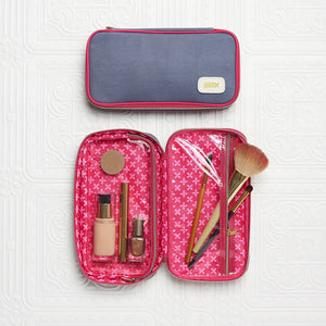 Inside of beauty case with clear compartment for makeup and brushes