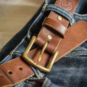 ageing leather belt and denim jeans