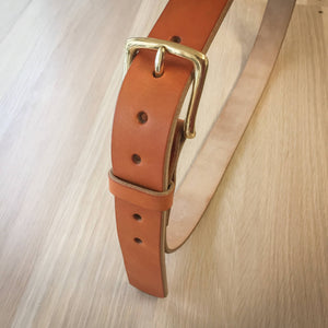 Tan leather belt with brass hardware