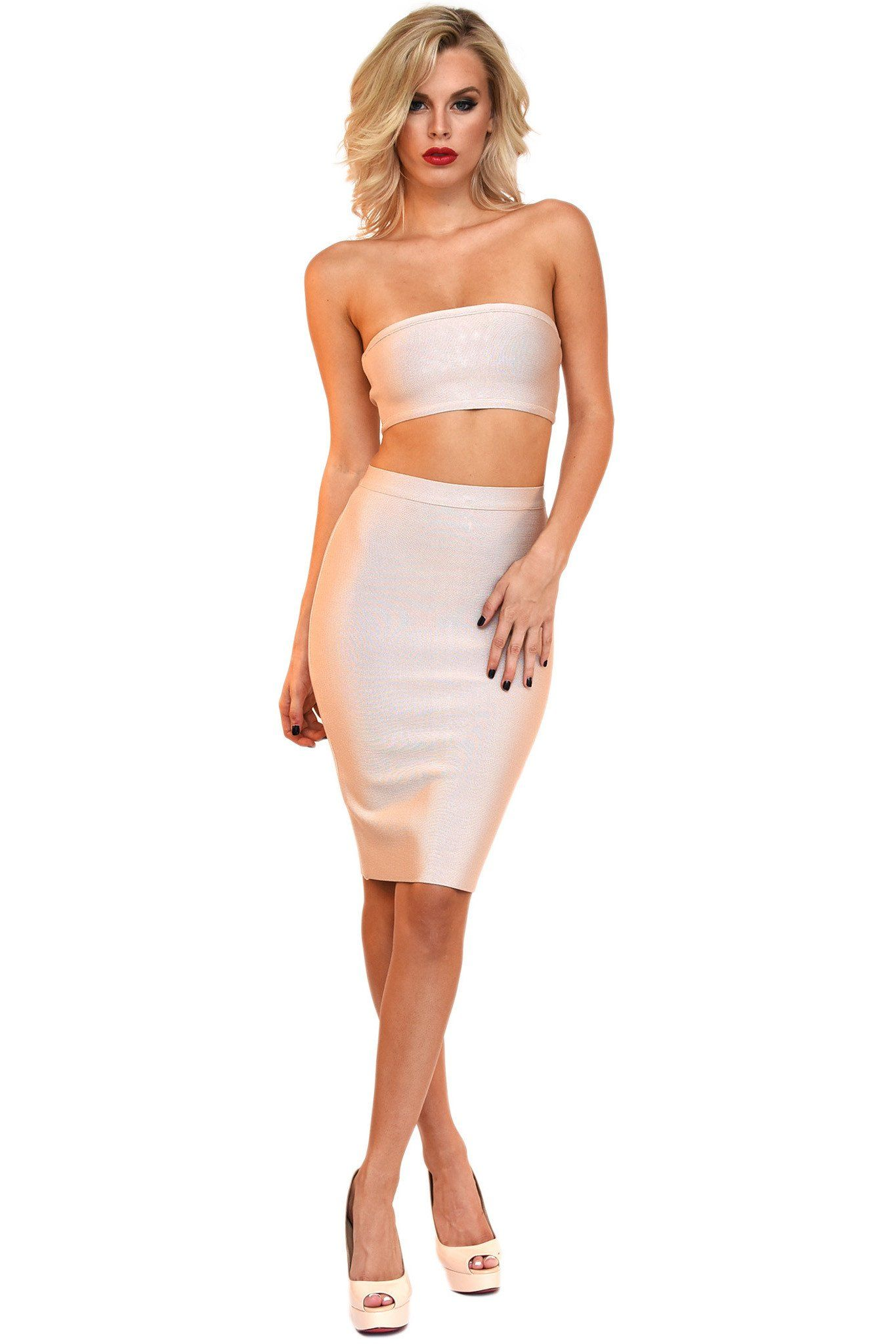 Front of nude colored two piece bandage set including a bandeau top and midi pencil skirt