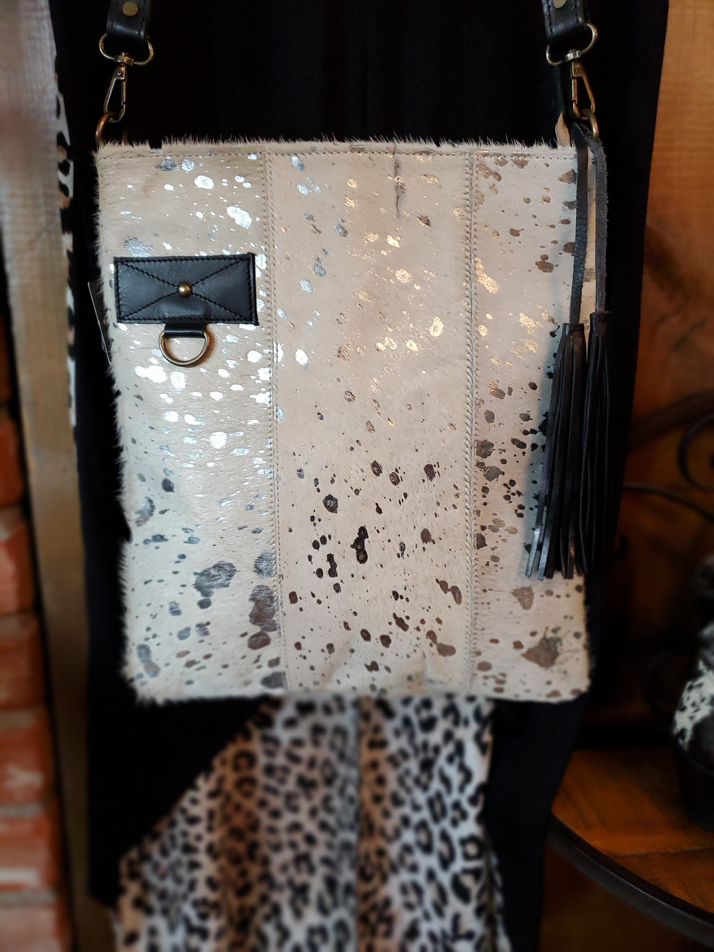 Black and White and Silver Cowhide Handbag with Black Leather Crossbody Strap