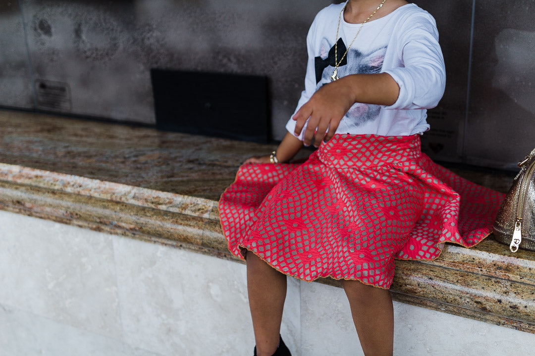 Girl wearing coral skirt