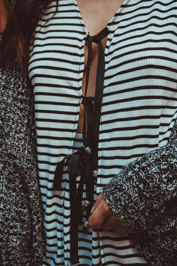black and white striped top with center split