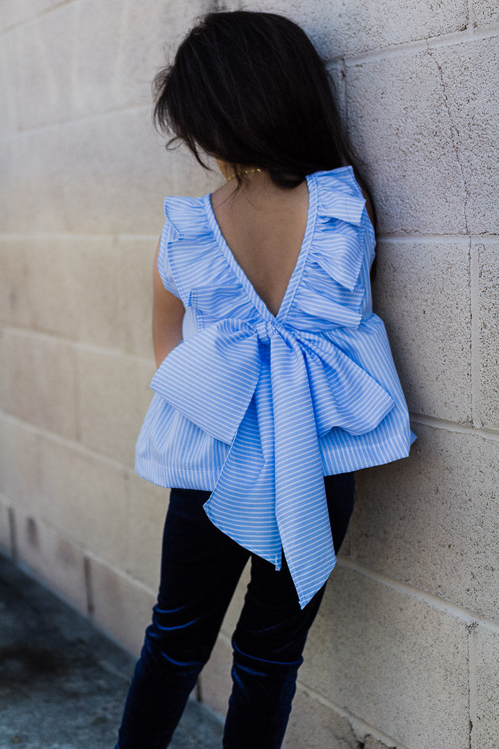blue bow top worn by toddler girl