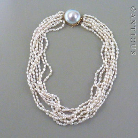 Eight-Strand Pearl Necklace with Large Mabé Pearl Clasp.