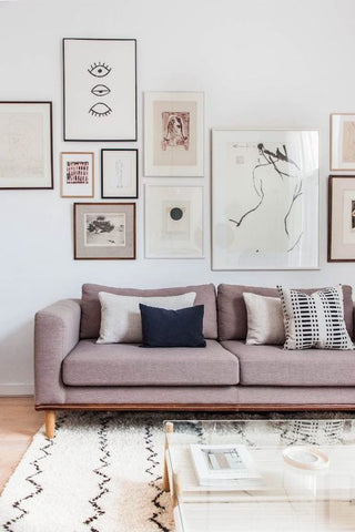 pink couch and artwork