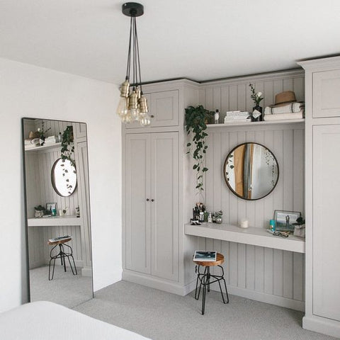 grey dressing table between wardrobes