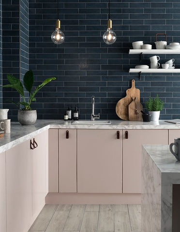 pink cabinets and grey tiles in kitchen