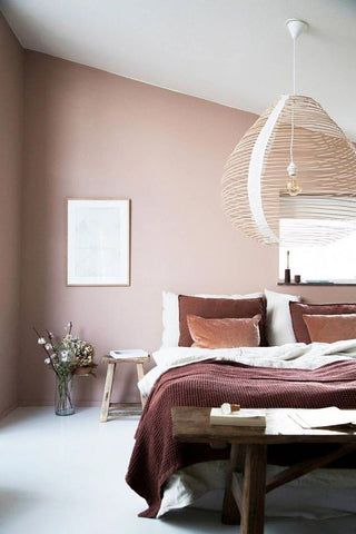 maroon bedding and pink wall in bedroom