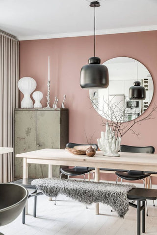 pink dining room with natural wood dining table