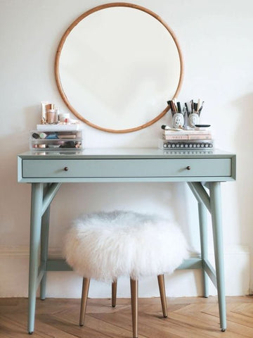 round mirror and mint green dressing table