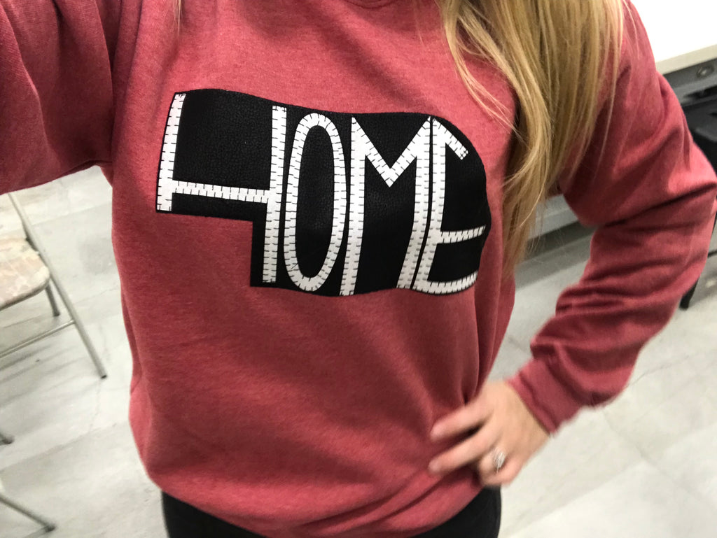 Red crewneck with HOME