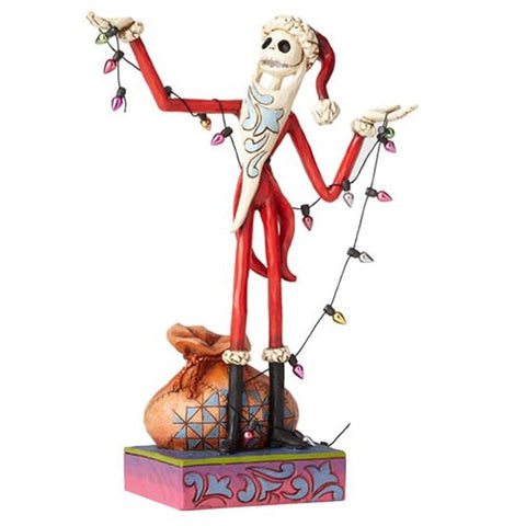 PRE-ORDER: Enesco Disney Traditions Nightmare Before Christmas Santa Jack with Christmas Wrapped Up in Christmas Spirit Statue