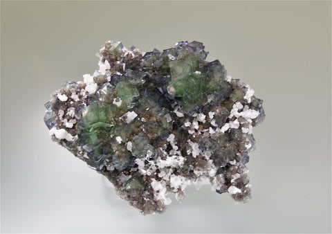 Fluorite with Quartz, Okoruso Fluorspar Company, Otjiwarongo District, Otjosondjupa Region, Namibia, Kalaskie Collection #42-89, Small Cabinet 3.0 x 6.5 x 8.0 cm, $250. Online 11/2