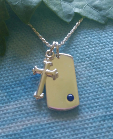 Charming engraveable ID with birthstone and cross.