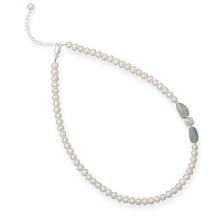 Classic pearl strand with aquamarine accents.