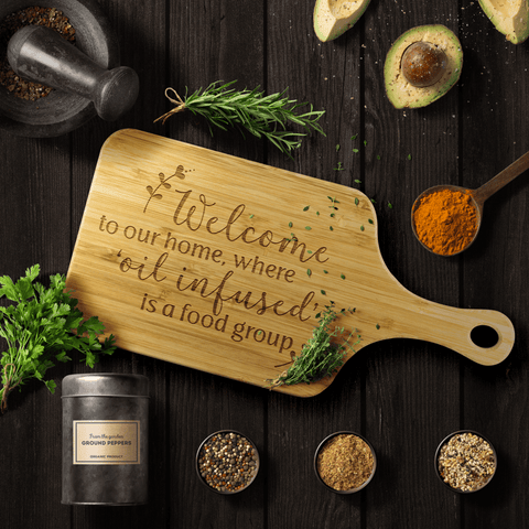 Bamboo Wood Cutting Board (with Handle) - Welcome to our home, where 'oil infused' is a food group.