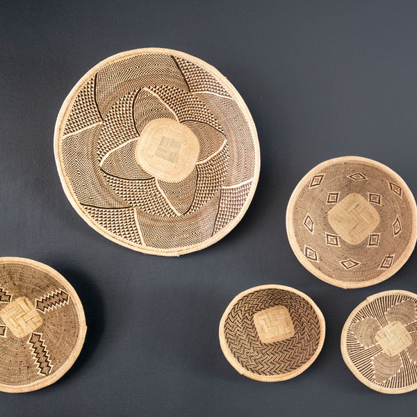 African batonga baskets grouped on a wall