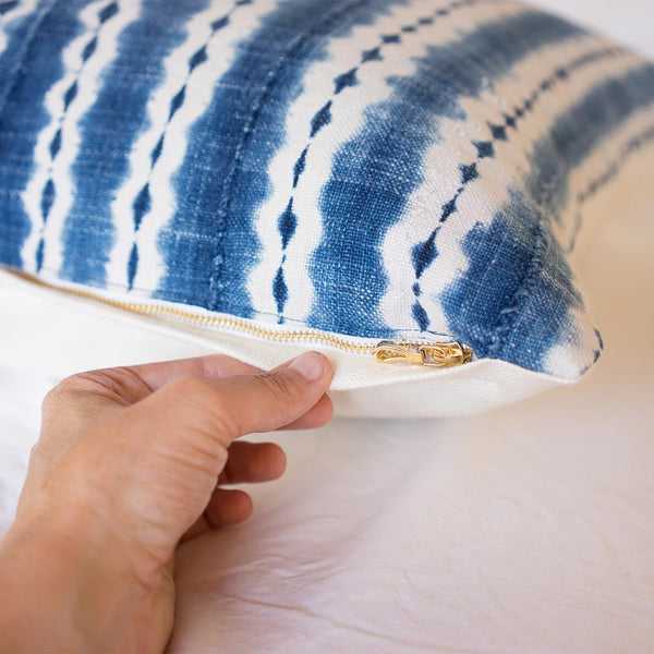Hidden gold zipper on Clover African indigo pillow