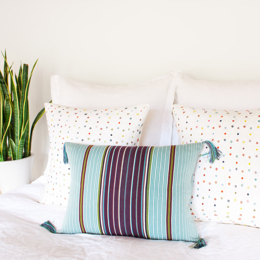 Mayan Tassels Pillow from El Camino de Los Altos styled on bed