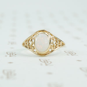 delicate yellow gold filigree opal ring
