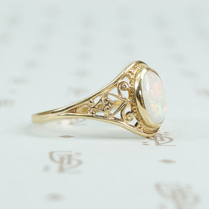 delicate yellow gold filigree opal ring side view
