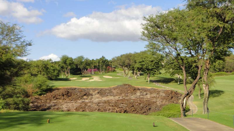 Hitting over the lava on the 9th hole at Wailea Gold