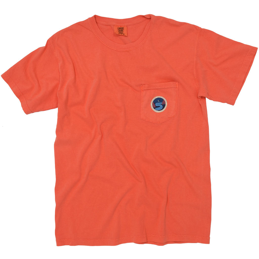 Bright orange t shirt with a picture of a river flowing through stand the moon in the Ozark Mountains.