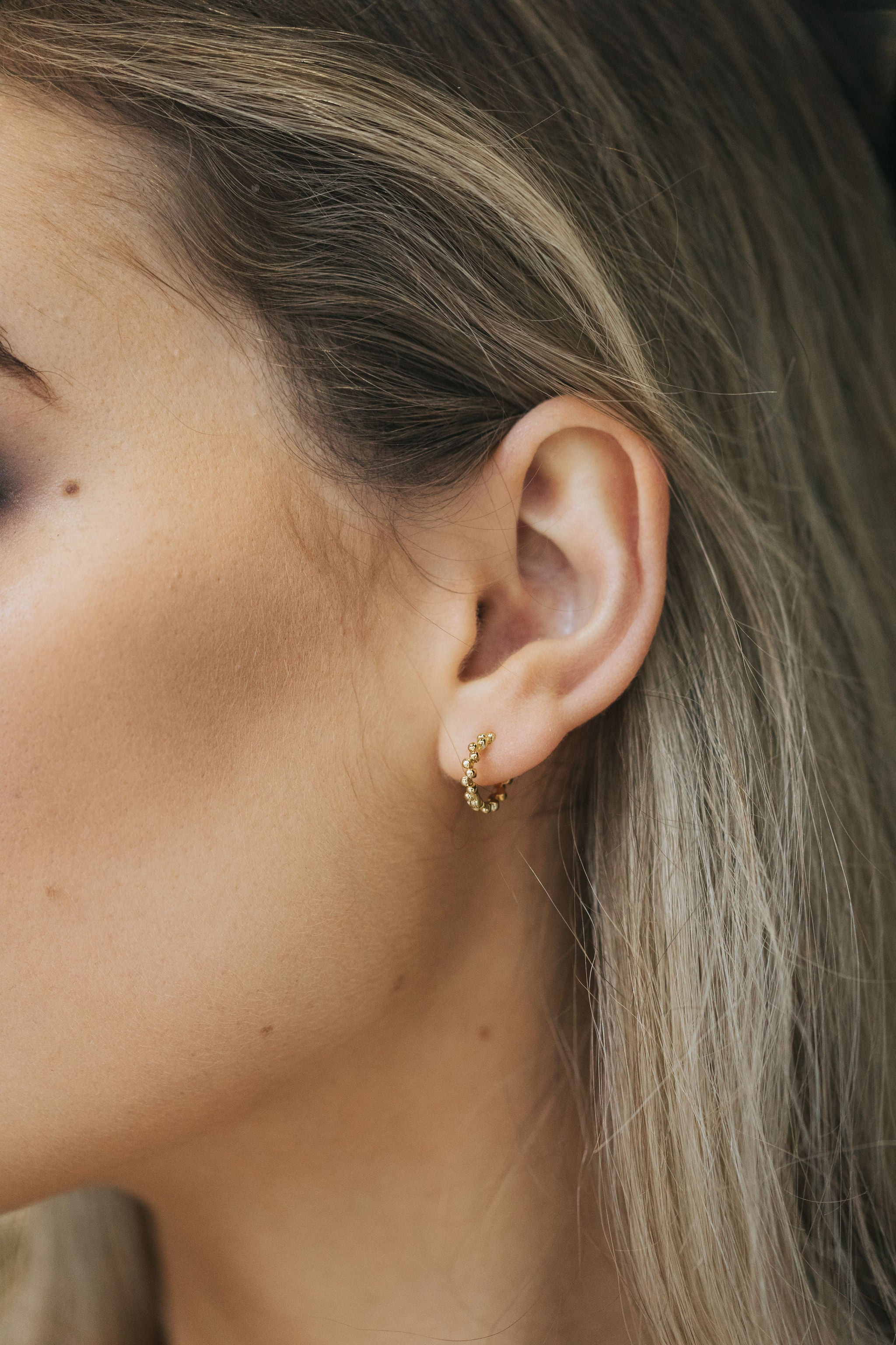 Iris mini hoops. sterling silver, rose gold plated