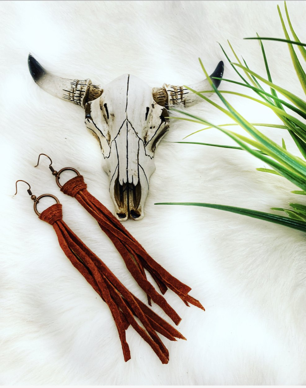 Leather fringe earrings are a must this year for every outfit!