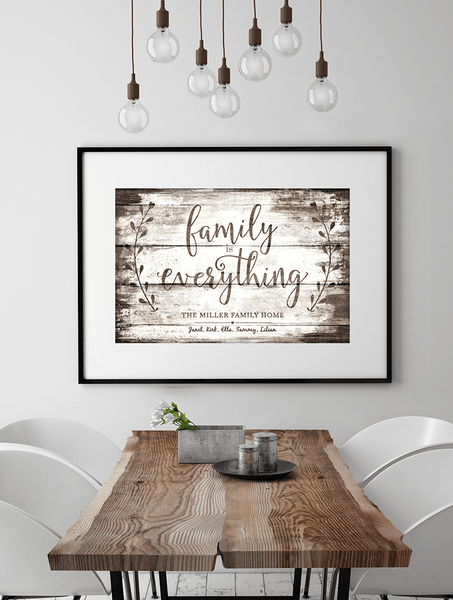 Modern dining room with vintage touches and a framed Family Is Everything - Vintage personalized print on the wall
