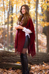 Young woman with a Burgundy poncho handmade of 100% Peruvian alpaca wool